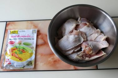 Image of chicken cut into small pieces with khao mok gai seasoning