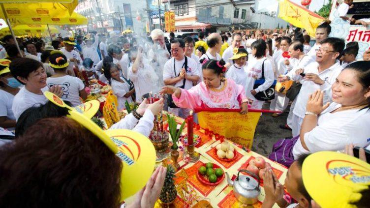 Image of white dressed Thais at vegetarian festival