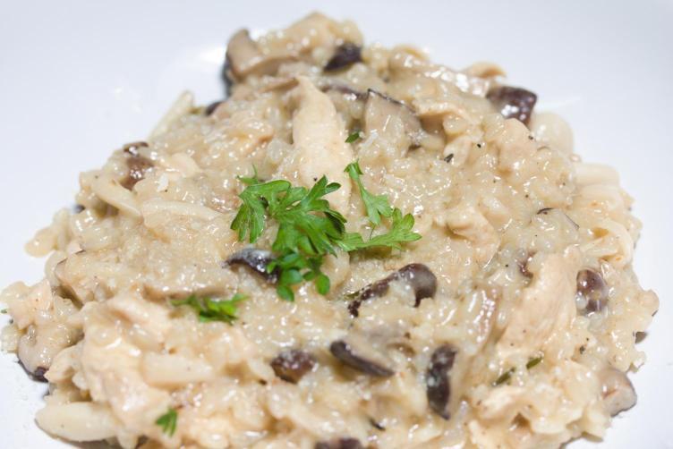 Photo of creamy chicken adn mushroom risotto plated