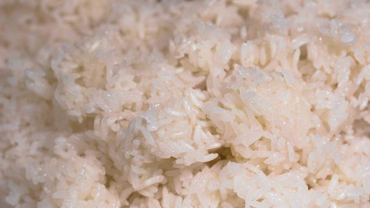 Photo of wet and sticky rice all clumped from boiling and then steaming - the worst method