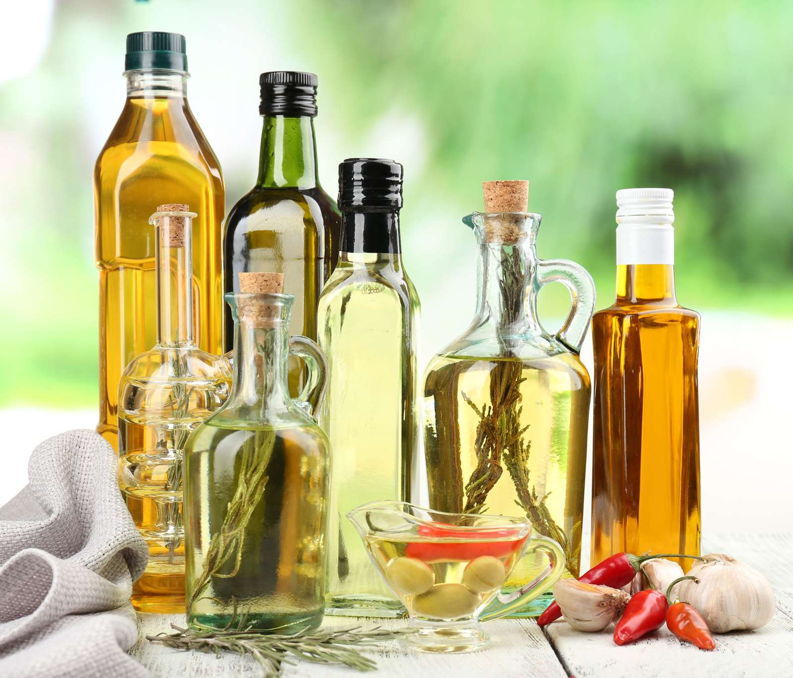 Image of glass bottles filled with quality cooking oil and some infused with herbs