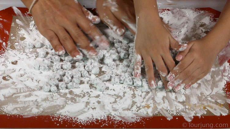photo of boba pearls being rolled in tapioca flour after rolling into pearls to stop them sticking