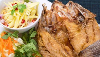 photo of perfectly deep fried sea bass with sweet fish sauce and delicious mango salad