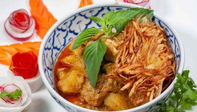 Photo of Thai Massaman Gai with potato nests and decorations