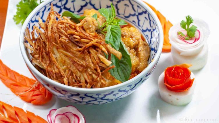 Photo of thai Massmana Chicken Curry featuring fried potato nests