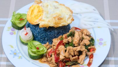 photo of pad krapow gai served with fried egg