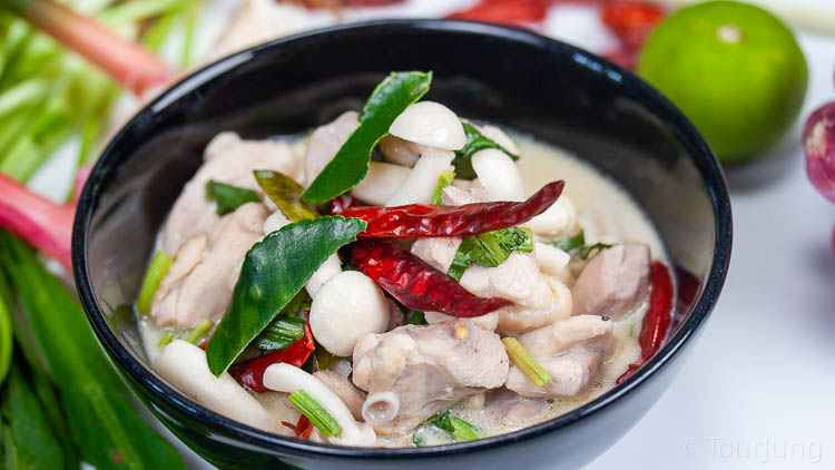 Photo of Tom Kha Gai in a black bowl for a different look