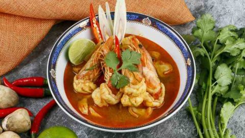 photo of Tom Yum Kung Soup in a blue serving bowl