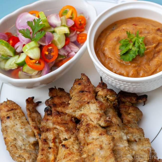 Photo of chicken satay skewers with peanut sauce & sweet pickles