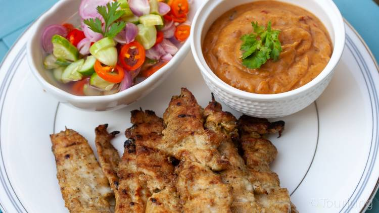 photo of chicken satay skewers and peanut sauce with sweet Thai pickles