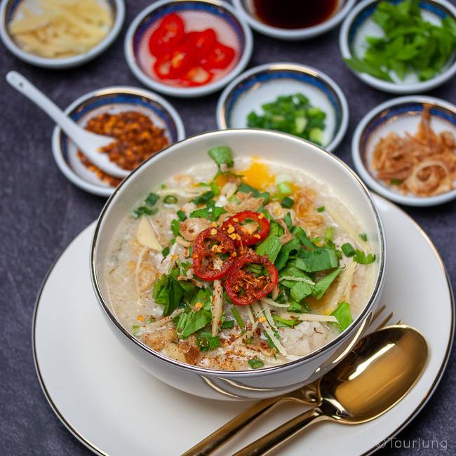 photo of Rice Soup with Chicken and condiments