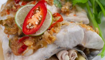 photo of delicious thai style steamed sea bass