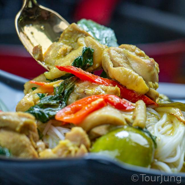 photo of That green curry with rice noodles ready to eat