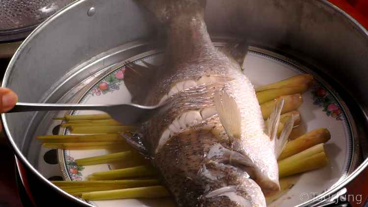 photo of whole fish in large steamer