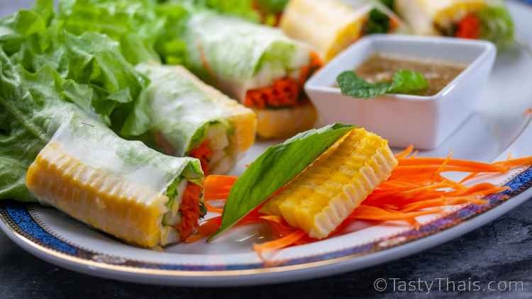 photo with a low angle showing close up of vegan spring rolls