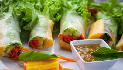 Spring rolls neatly wrapped in rice wrappers and filled with fresh and healthy vegetables all served with a piquant tasty tangy Thai dipping sauce. Sublime!