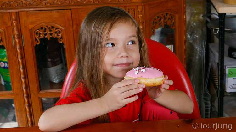 photo of Katie about to eat a donut after making wontons