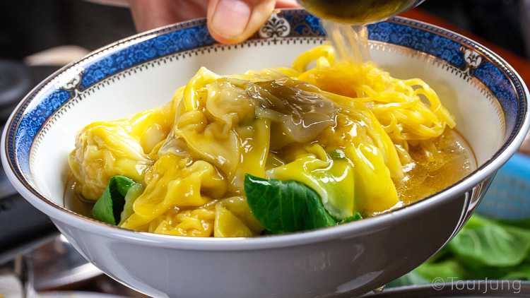 photo showing adding the wonton noodle soup broth