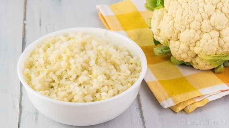 Cheesy stir fried cauliflower rice with yellow napkin