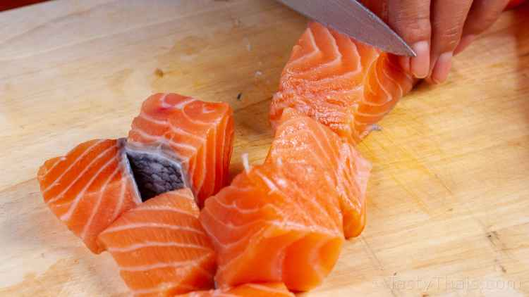 photo of cutting fresh salmon ingredient for Thai Red Curry