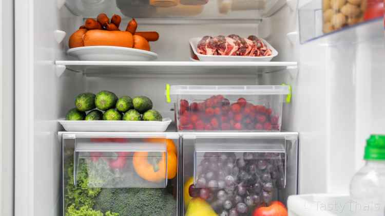 photo of full fridge where juices from raw produce can contaminate cooked food below