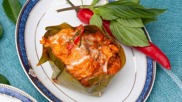 photo of Thai Red Curry with coconut milk and fresh salmon