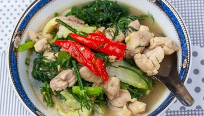 Kaeng Om or Thai clear soup cooked with chicken and herbs