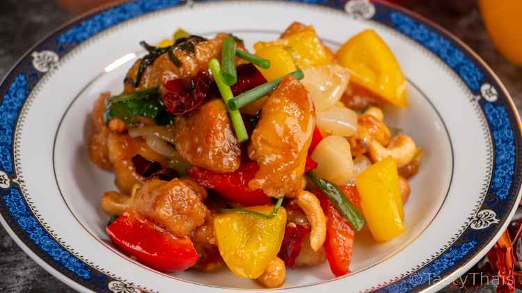 Chicken Cashew Nut Stir Fry Thai Served on a blue & white plate