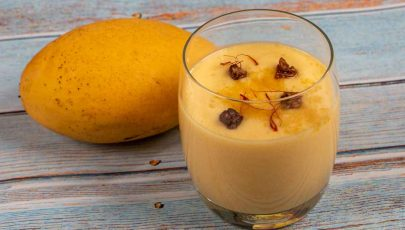 Mango lassi made with fresh mango or mango pulp or canned mango