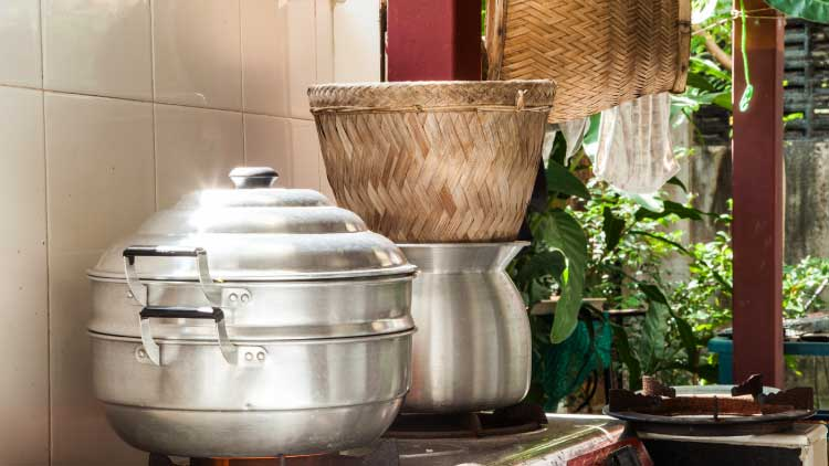 Thai Cookware image with steaming pots on a worktop