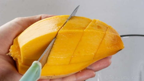 Peel the mango skin and fibrous underlayer too