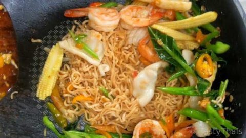 Add the noodles and seafood after stir frying the vegetables