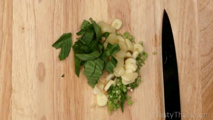 Preparing the ingredients for green seafood dipping sauce