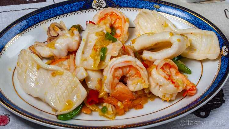 For drunken noodles stir fry the seafood or protein first to improve flavor
